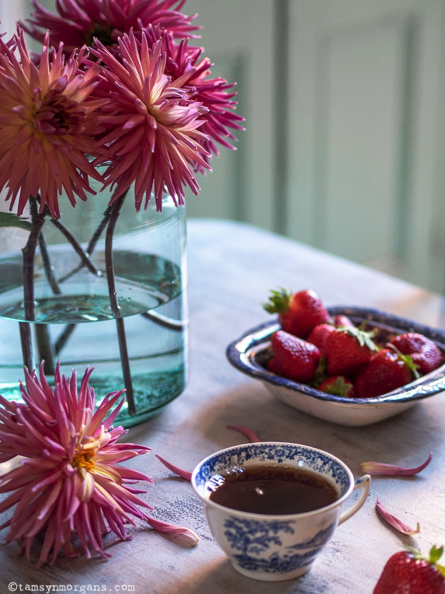 Still life of dahlias and strawberries