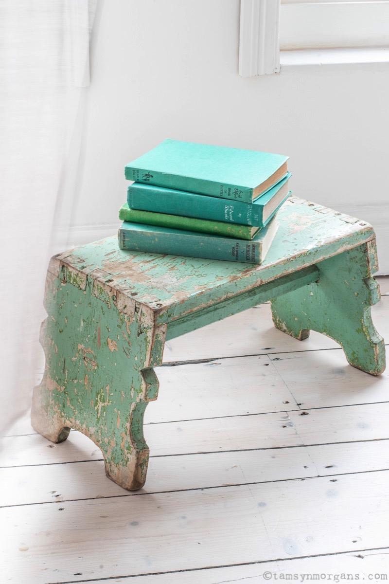 Chippy green stool