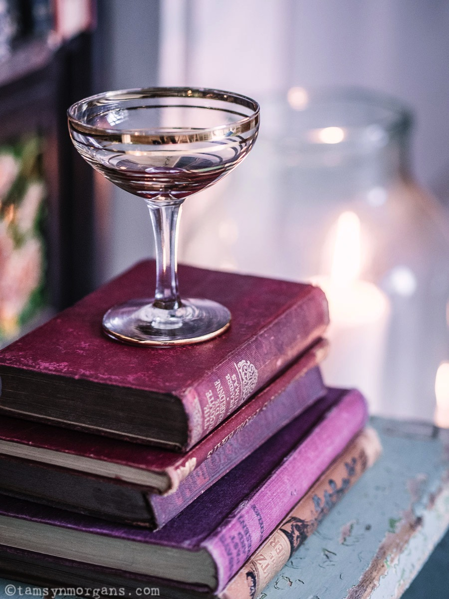 Vintage champagne glass and books