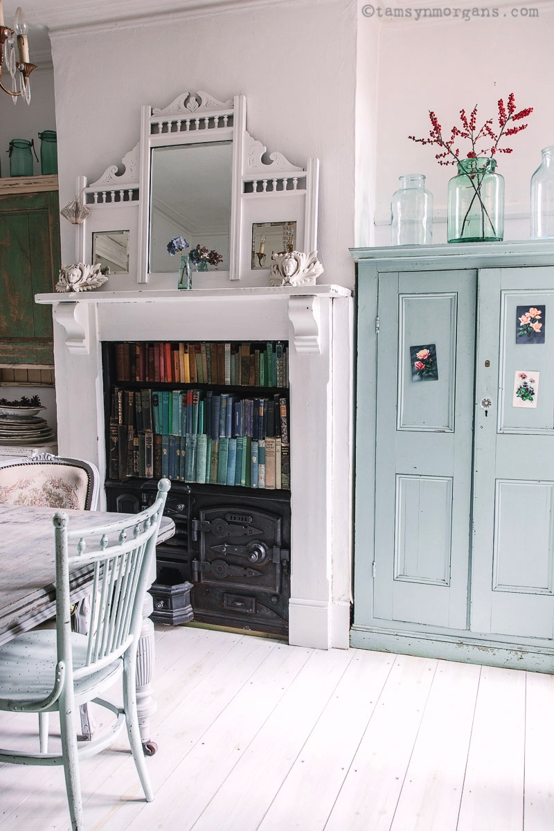 Vintage home with old books and painted furniture