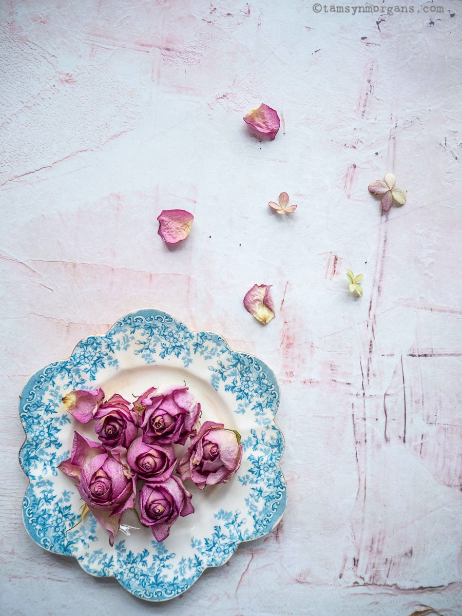 Roses on blue and white vintage saucer