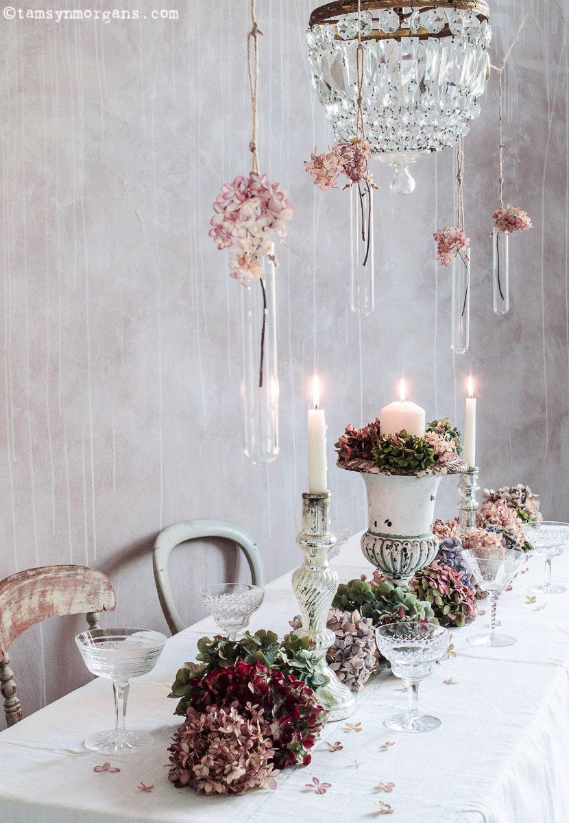 Winter dining table with candles and hydrangeas