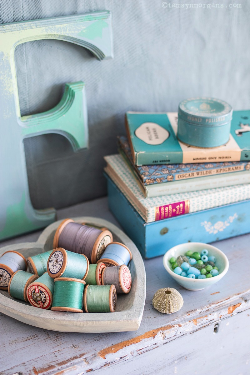 Duck egg blue cotton reels and books