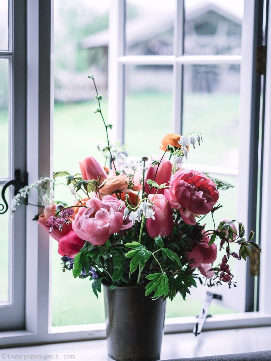 Vase of flowers on window sill