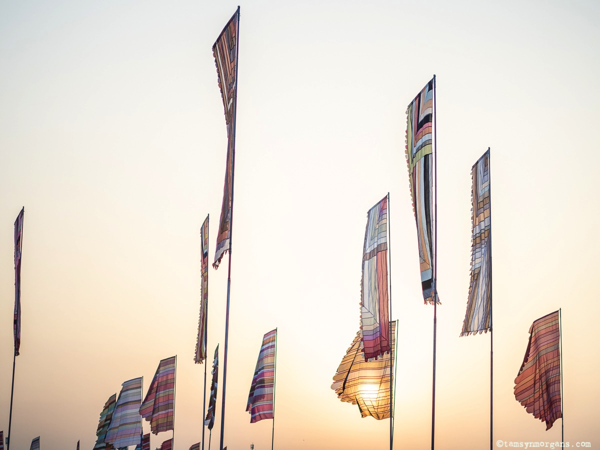 Flags in the golden hour at Glastonbury Festival
