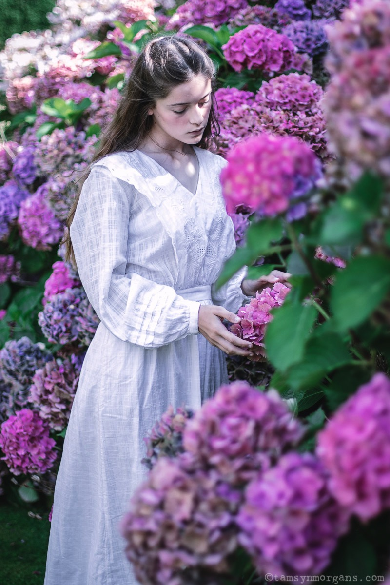 Portrait of girl with hydrangeas