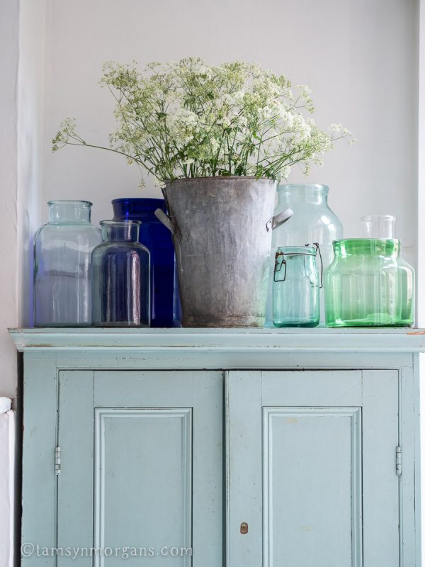 Vintage cupboard with glass vases