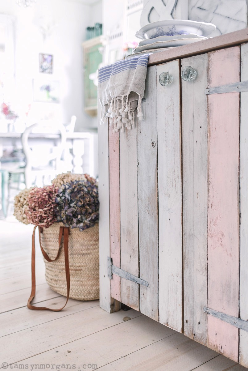 Reclaimed pallet doors in pastel colours