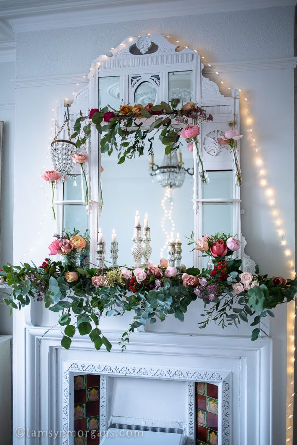 Floral installation on mantelpiece