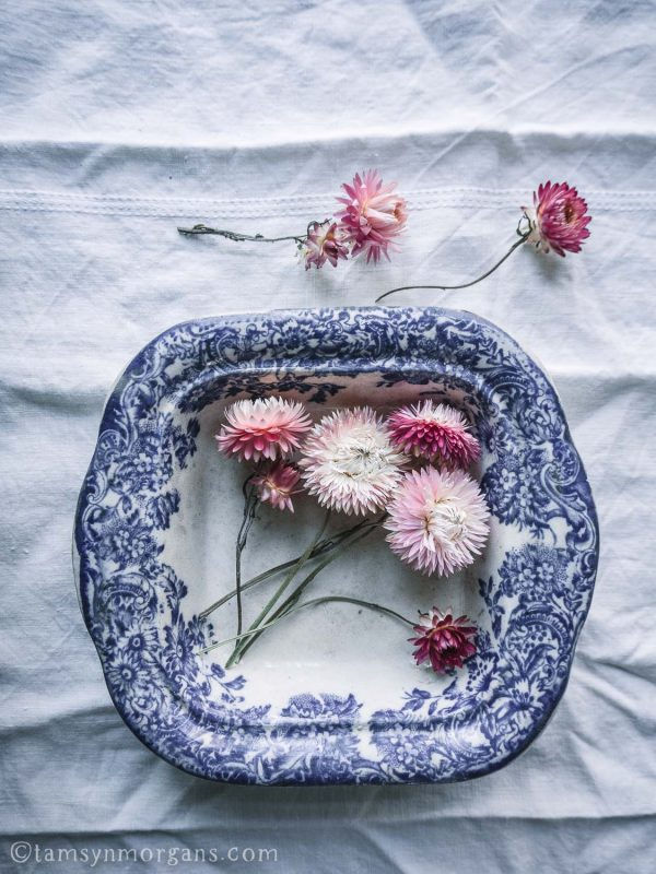 Pink straw flowers in vintage bowl