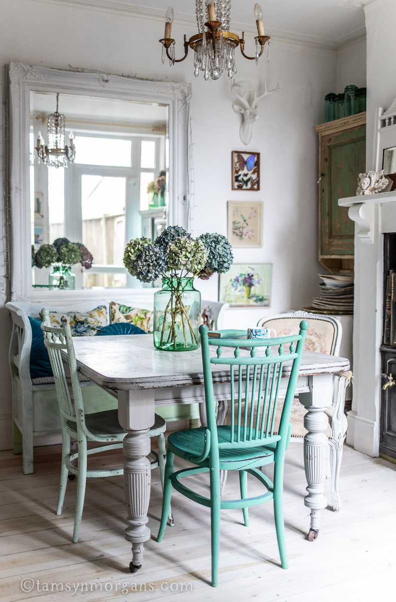 Antique dining table with painted chairs